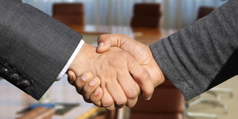 Handschlag Zwischen Zwei Männern Germania Inkasso Erfolgreiches Forderungsmanagement